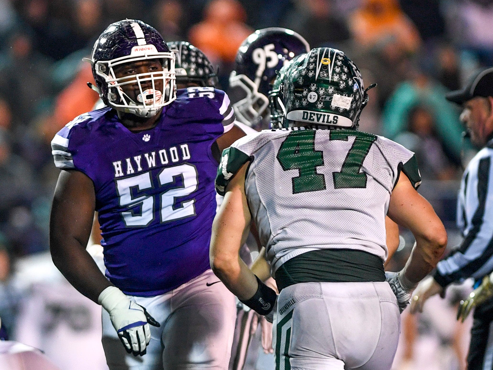 Haywood's Kendall Bond (52) reacts calmly after being punched by Greeneville's Ty Youngblood (47) during the Class 4A Blue Cross Bowl between Haywood and Greeneville at Tennessee Tech's Tucker Stadium in Cookeville, Tenn., on Thursday, Nov. 29, 2018.