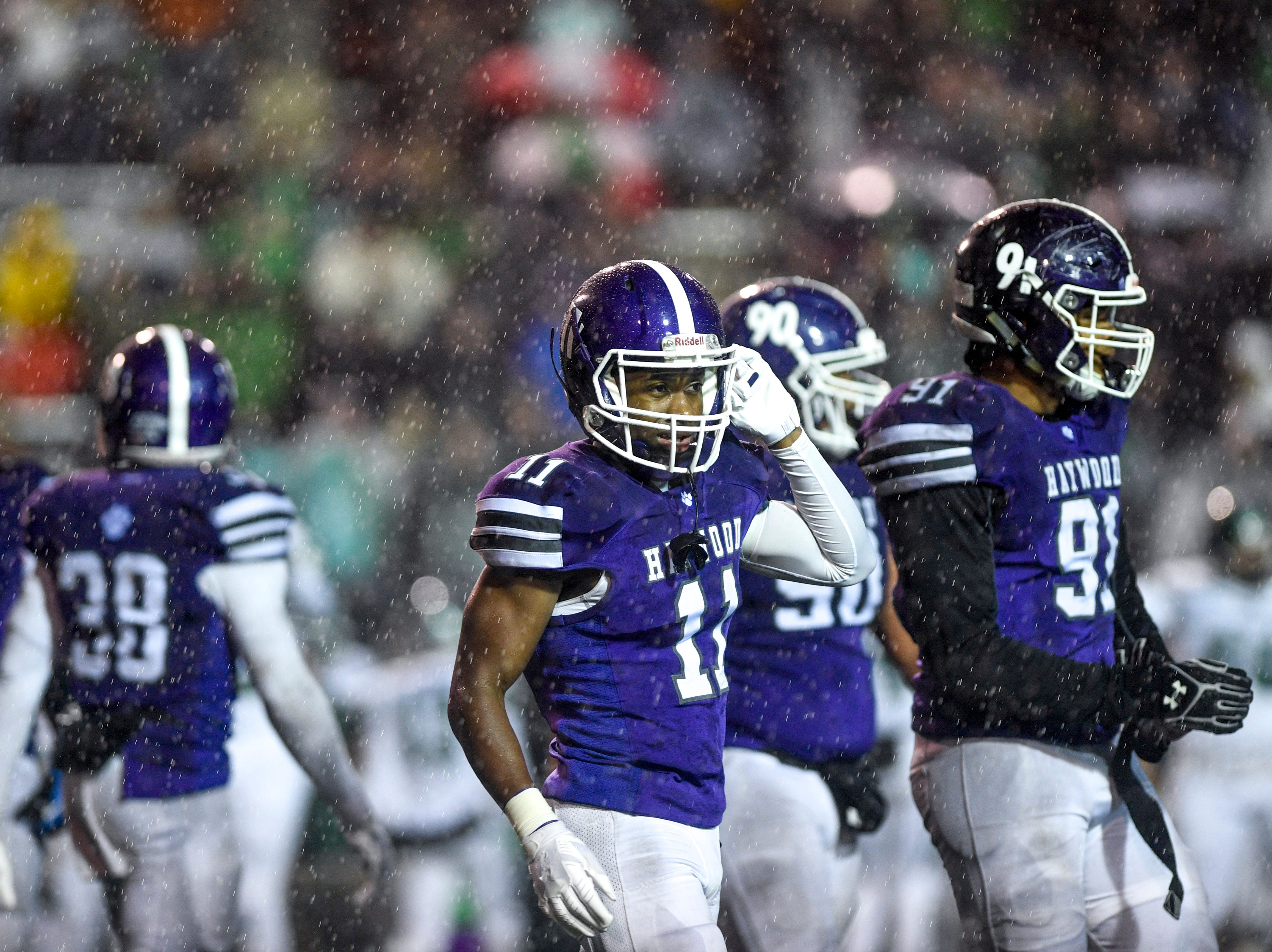 Haywood's Jakobe Swift (11) pulls off his helmet strap in the last few seconds of the game during the Class 4A Blue Cross Bowl between Haywood and Greeneville at Tennessee Tech's Tucker Stadium in Cookeville, Tenn., on Thursday, Nov. 29, 2018.