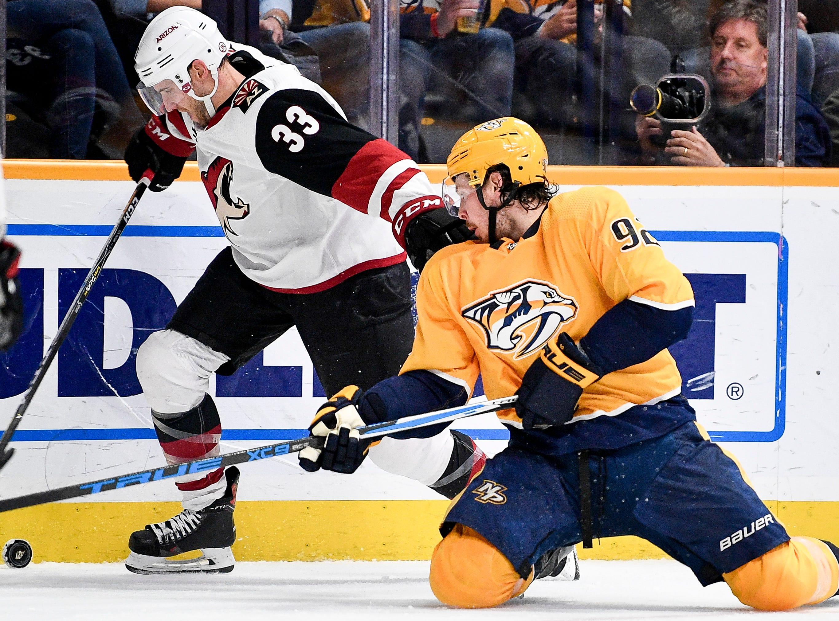 Arizona Coyotes goaltender Calvin Pickard (33) battles Nashville Predators center Ryan Johansen (92) during the third period at Bridgestone Arena in Nashville, Tenn., Thursday, Nov. 29, 2018.
