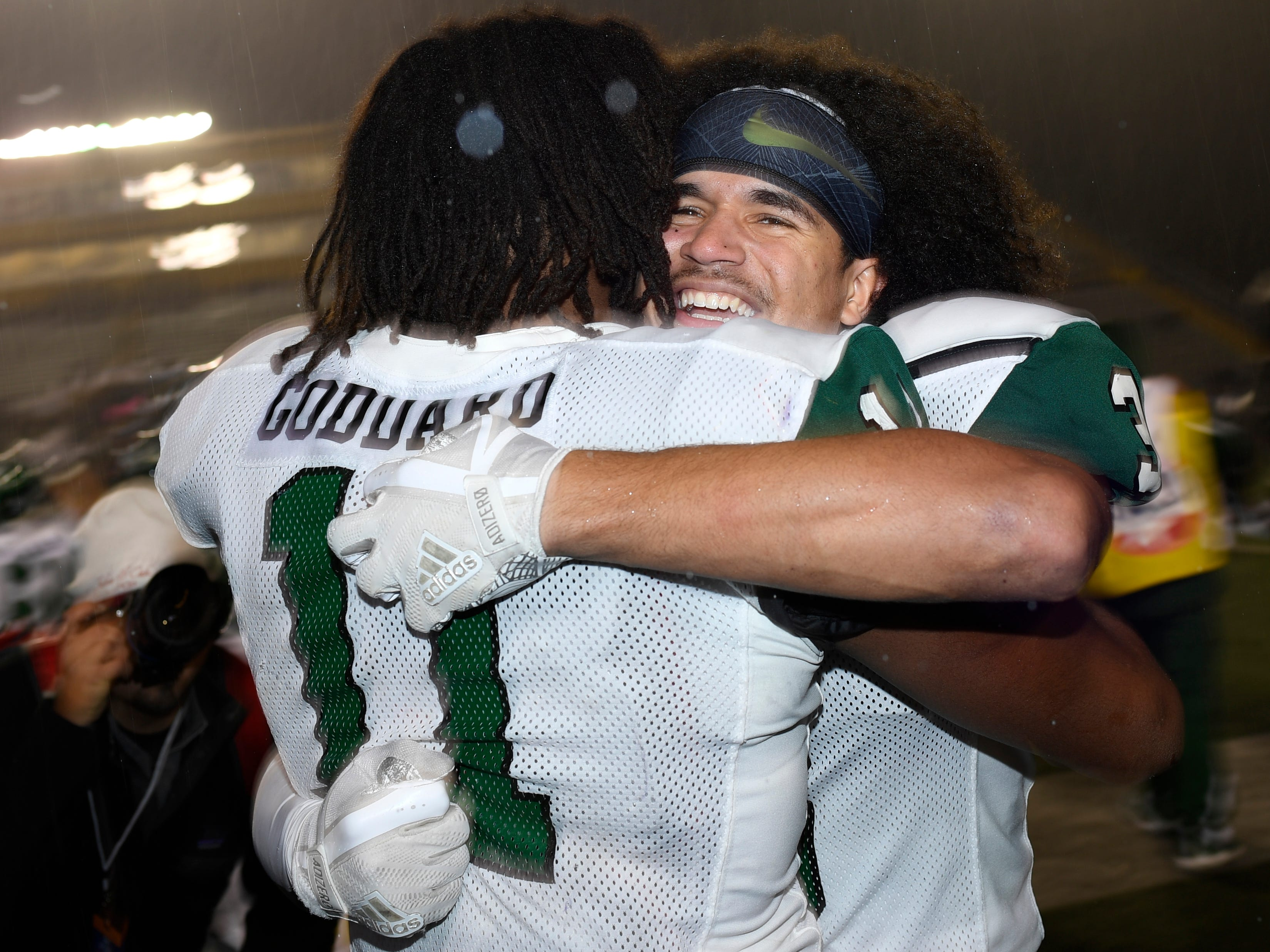 Greeneville's Jordan Gillespie (3) and Dorien Goddard (11) celebrate the team's 56-21 win in the Class 4A BlueCross Bowl state championship at Tennessee Tech's Tucker Stadium in Cookeville, Tenn., on Thursday, Nov. 29, 2018.