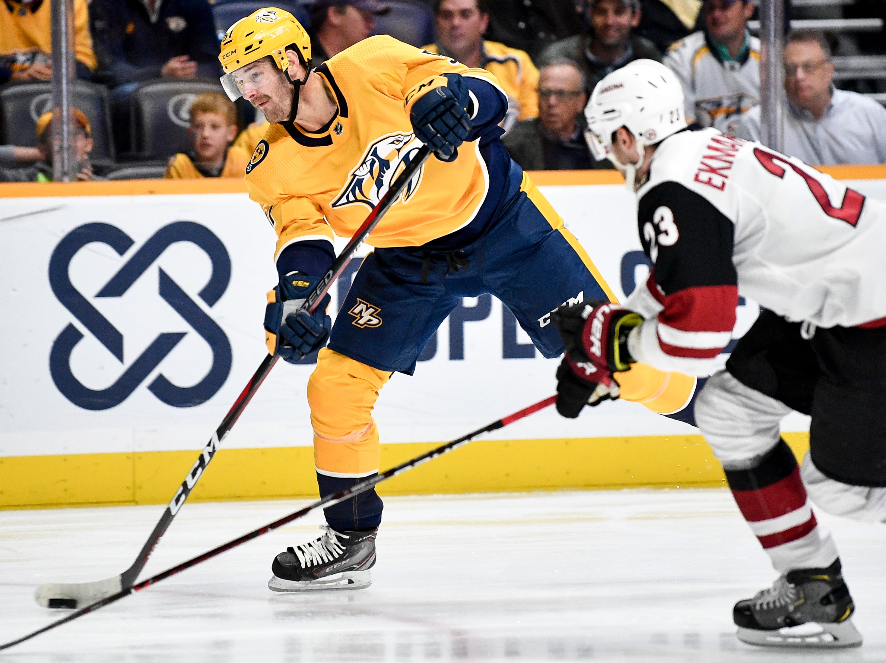 Nashville Predators left wing Austin Watson (51) shoots past Arizona Coyotes defenseman Oliver Ekman-Larsson (23) during the first period at Bridgestone Arena in Nashville, Tenn., Thursday, Nov. 29, 2018.