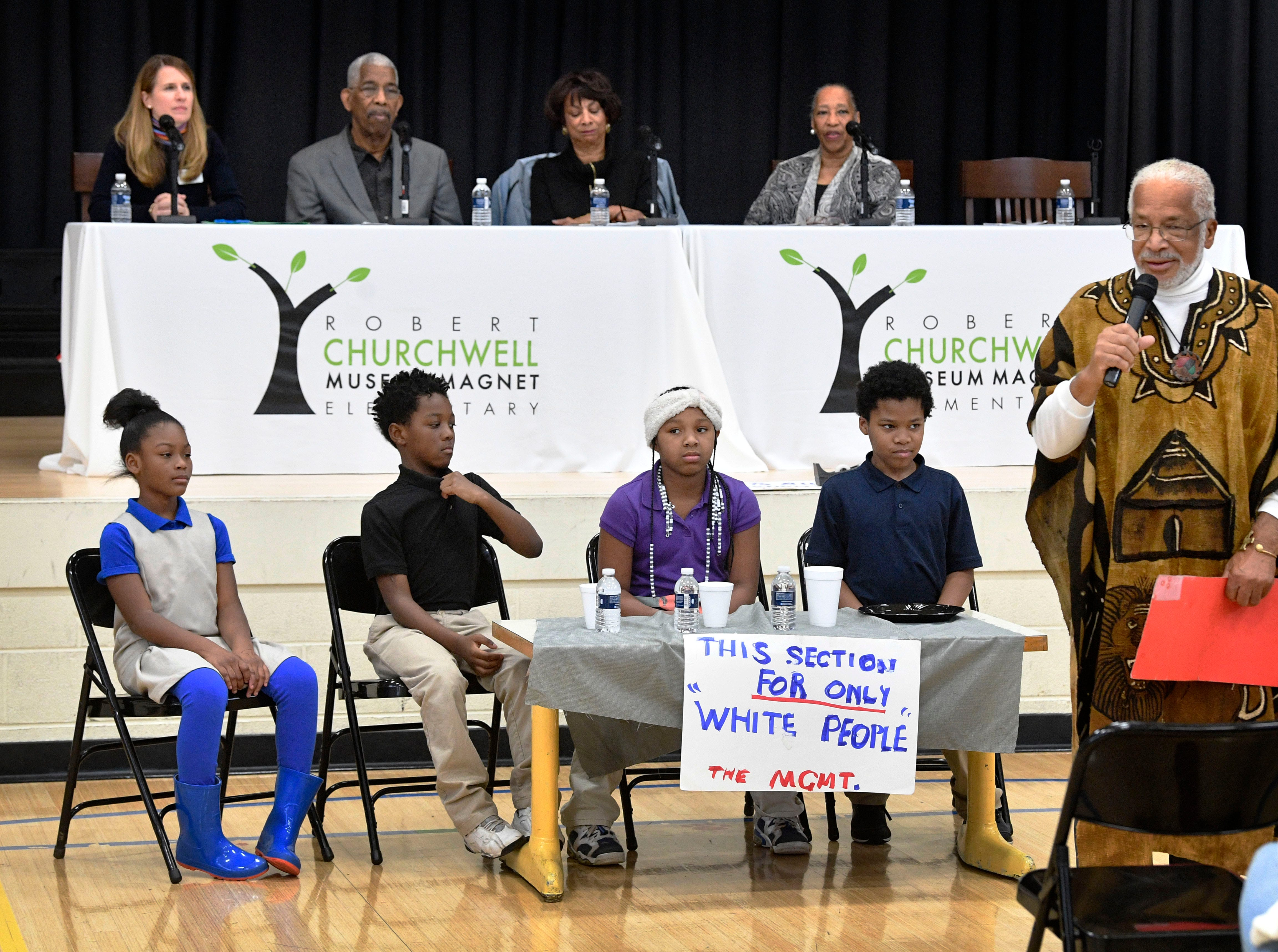 "Kwame Lillard took students ""back in time to the 1960 lunch counters"" during a presentation as part of the Frist Art Museum's ""We Shall Overcome"" exhibition opening at the Robert Churchwell Museum Magnet School. To celebrate its opening, the school hosted an assembly that featured remarks by the principal and a conversation with several participants, including Lajuanda Street Harley, Kwame Lillard, Rip Patton, and Gloria McKissack.  Friday Nov. 30, 2018, in Nashville, Tenn."