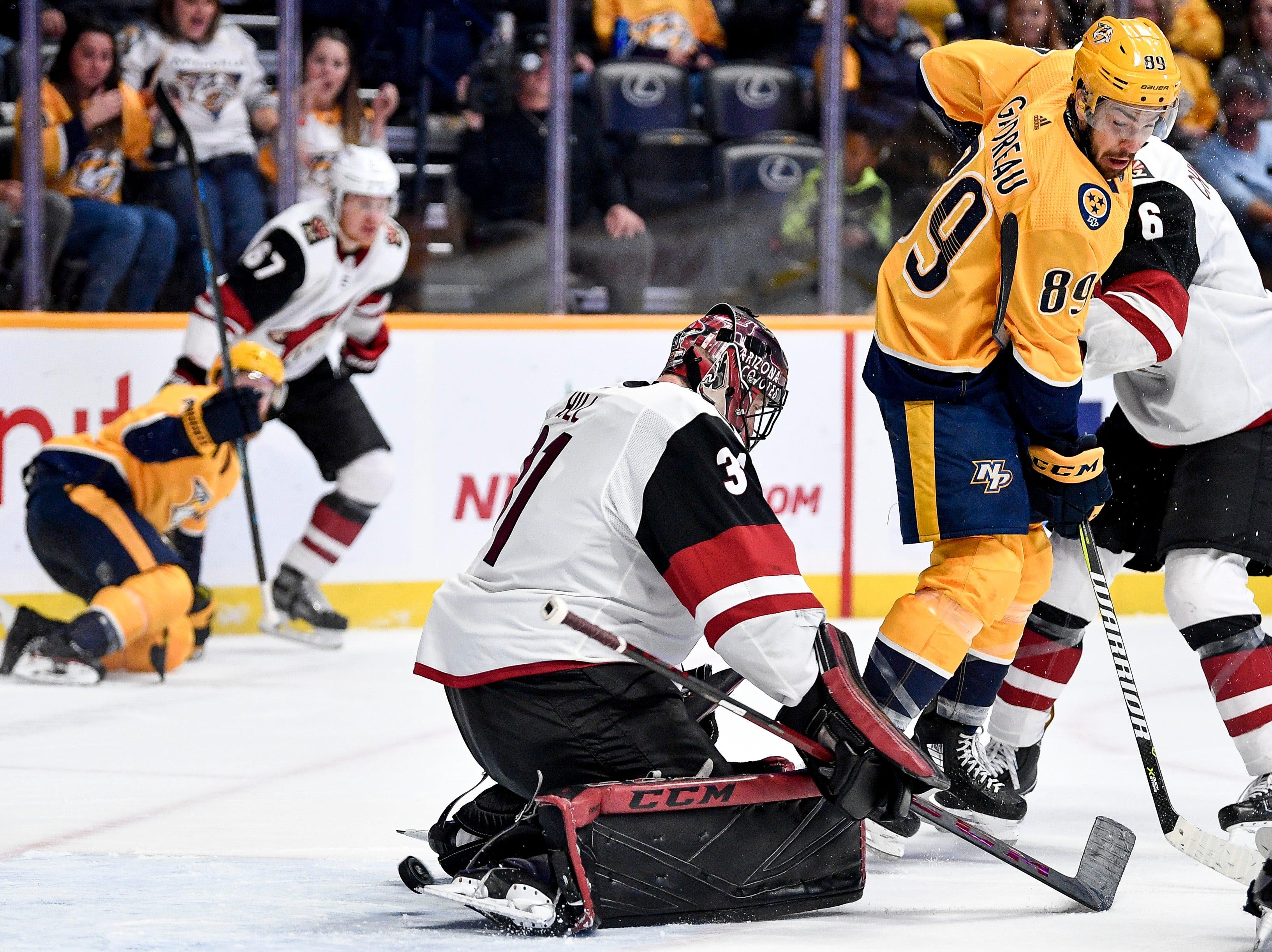 A Nashville Predators shot slips past Arizona Coyotes goaltender Adin Hill (31) before landing outside of the net during the third period at Bridgestone Arena in Nashville, Tenn., Thursday, Nov. 29, 2018.