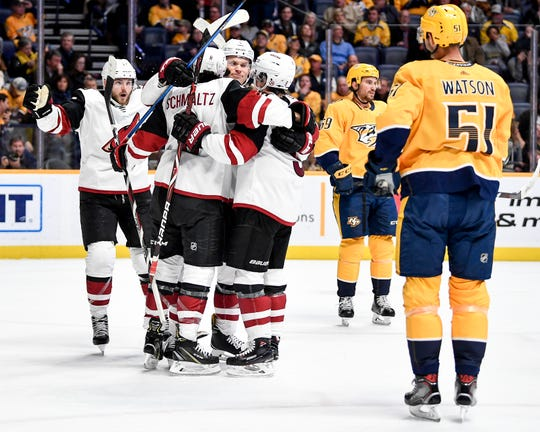 Arizona Coyotes center Nick Schmaltz (8) celebrates scoring against the Nashville Predators during the second period at Bridgestone Arena in Nashville, Tenn., Thursday, Nov. 29, 2018.