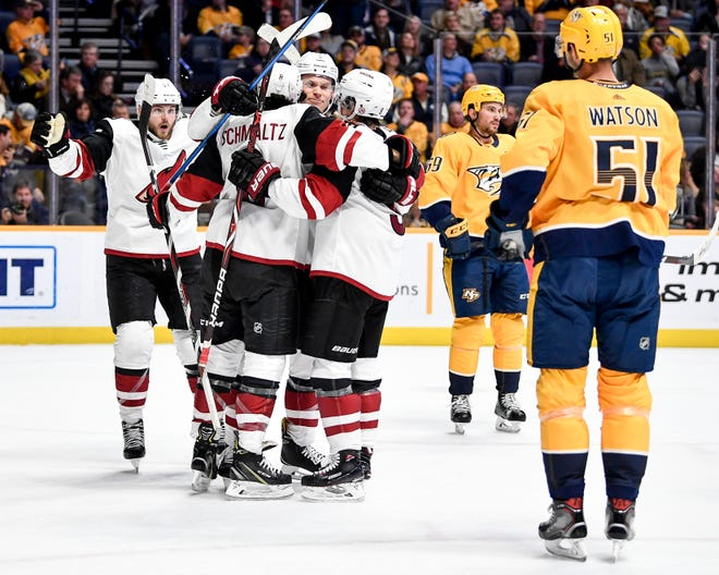 Arizona Coyotes center Nick Schmaltz (8) celebrates scoring against the Nashville Predators during the second period at Bridgestone Arena in Nashville, Tenn., Thursday, Nov. 29, 2018.