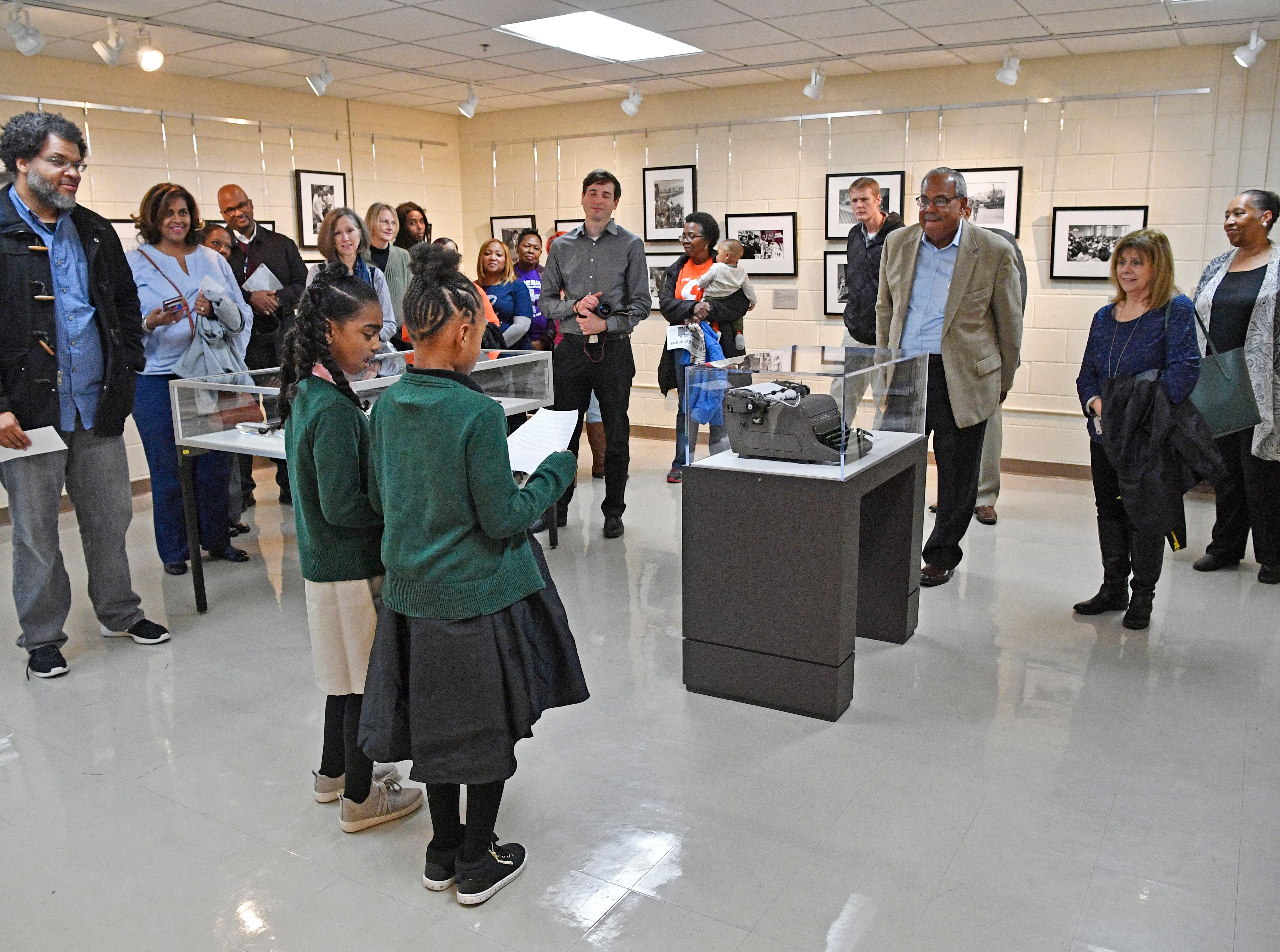 Students read an introduction to a significant part of We Shall Overcome exhibition that was presented at the Robert Churchwell Museum Magnet School. To celebrate its opening, the school hosted an assembly that featured remarks by the principal and a conversation with several participants, including Lajuanda Street Harley, Kwame Lillard, Rip Patton, and Gloria McKissack.