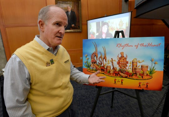 Bryan Langford stands with a drawing of the Donate Life float at Vanderbilt University on Thursday, Nov. 29, 2018, in Nashville. When his son, Justin Langford, died, his organs were donated and saved five lives and improved 70 others. A likeness of Justin's face will be created out of seeds and flowers and put on the float for the Rose Parade on Jan. 1, 2019.