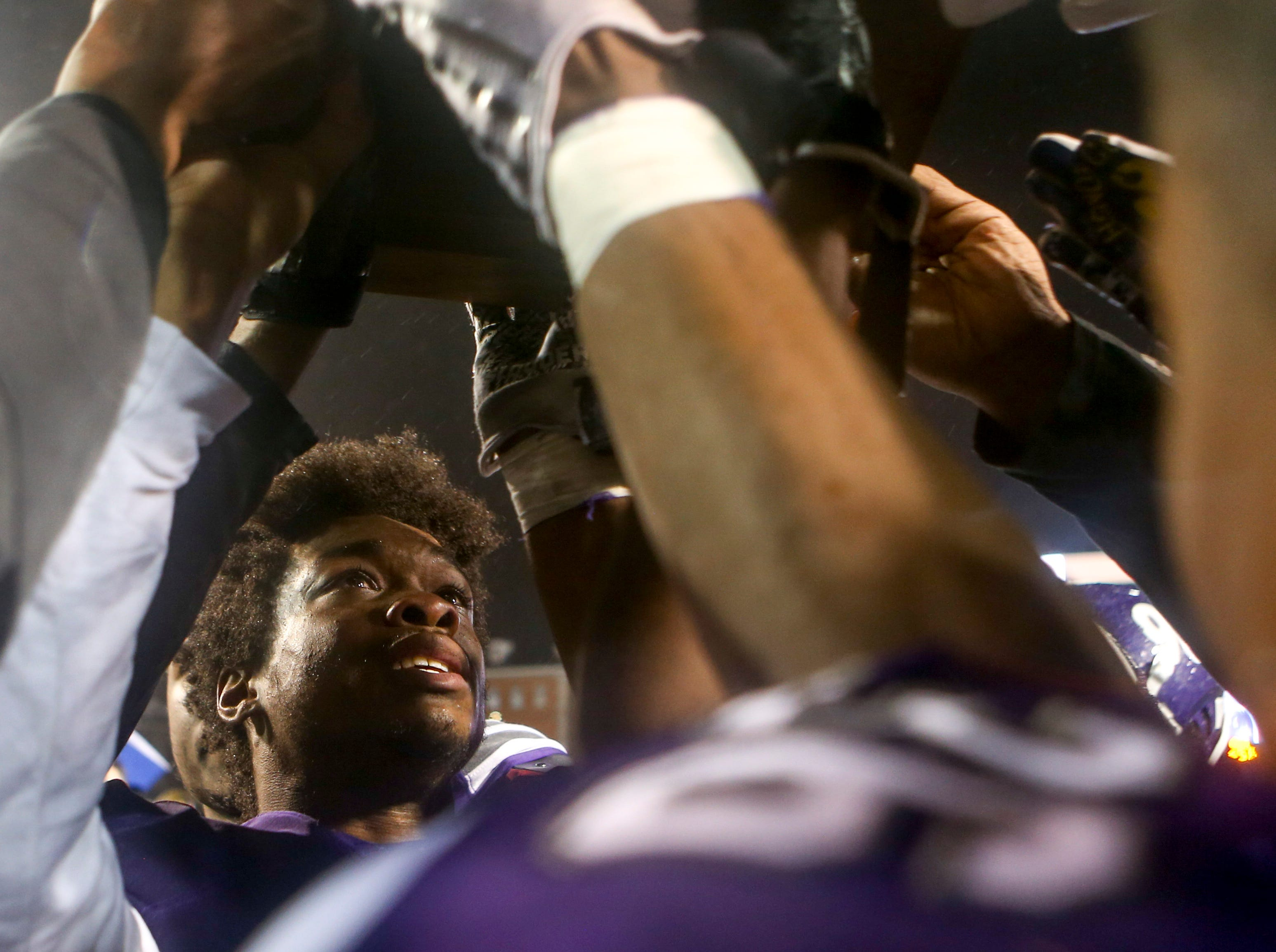 Haywood's Jadarius Tyus (22) looks up to the runner-up trophy after losing the Class 4A Blue Cross Bowl between Haywood and Greeneville at Tennessee Tech's Tucker Stadium in Cookeville, Tenn., on Thursday, Nov. 29, 2018.