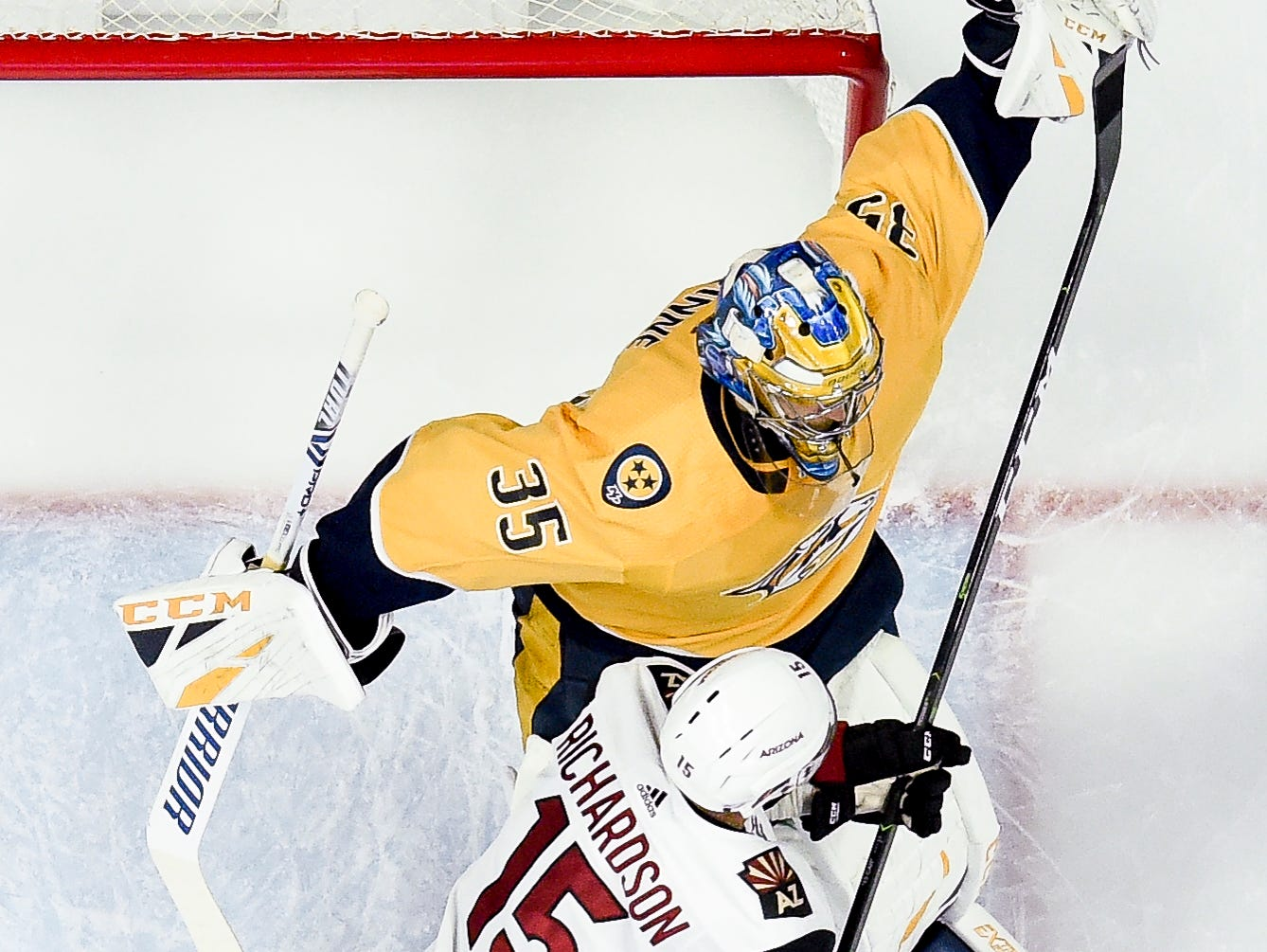 Nashville Predators goaltender Pekka Rinne (35) makes a save next to Arizona Coyotes center Brad Richardson (15) during the first period at Bridgestone Arena in Nashville, Tenn., Thursday, Nov. 29, 2018.