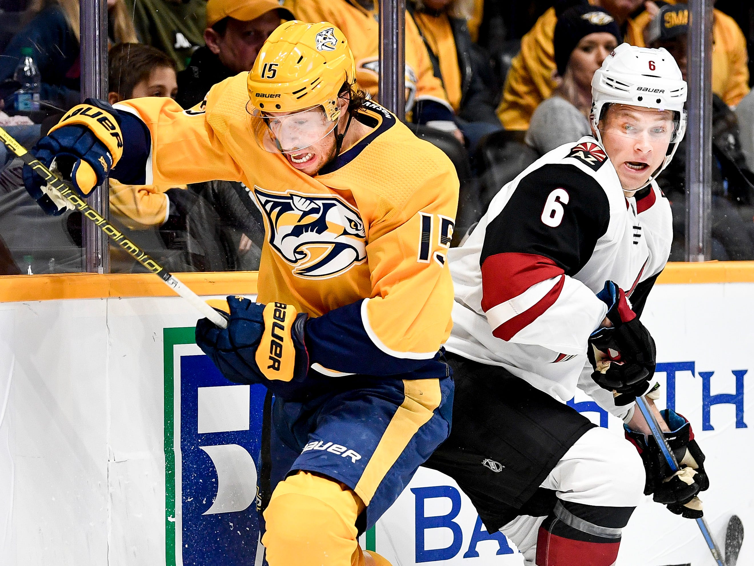 Nashville Predators right wing Craig Smith (15) fights for the puck with Arizona Coyotes defenseman Jakob Chychrun (6) during the first period at Bridgestone Arena in Nashville, Tenn., Thursday, Nov. 29, 2018.