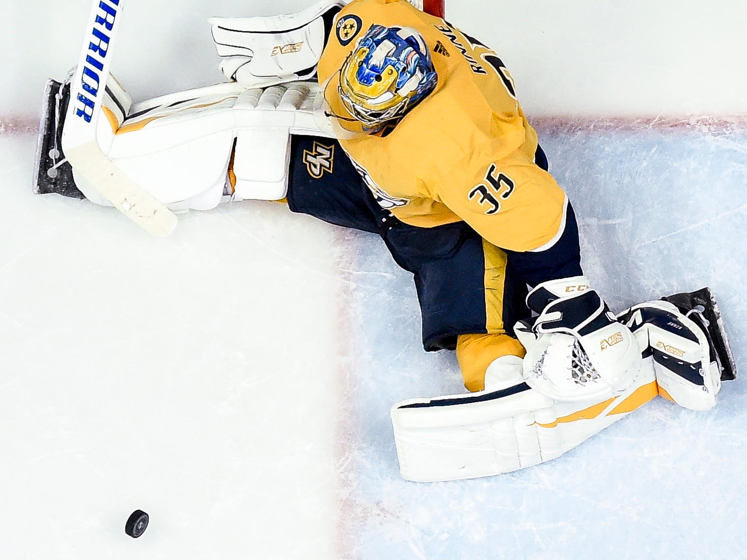 Nashville Predators goaltender Pekka Rinne (35) loses his stick while defending against an Arizona Coyotes shot during the third period at Bridgestone Arena in Nashville, Tenn., Thursday, Nov. 29, 2018.