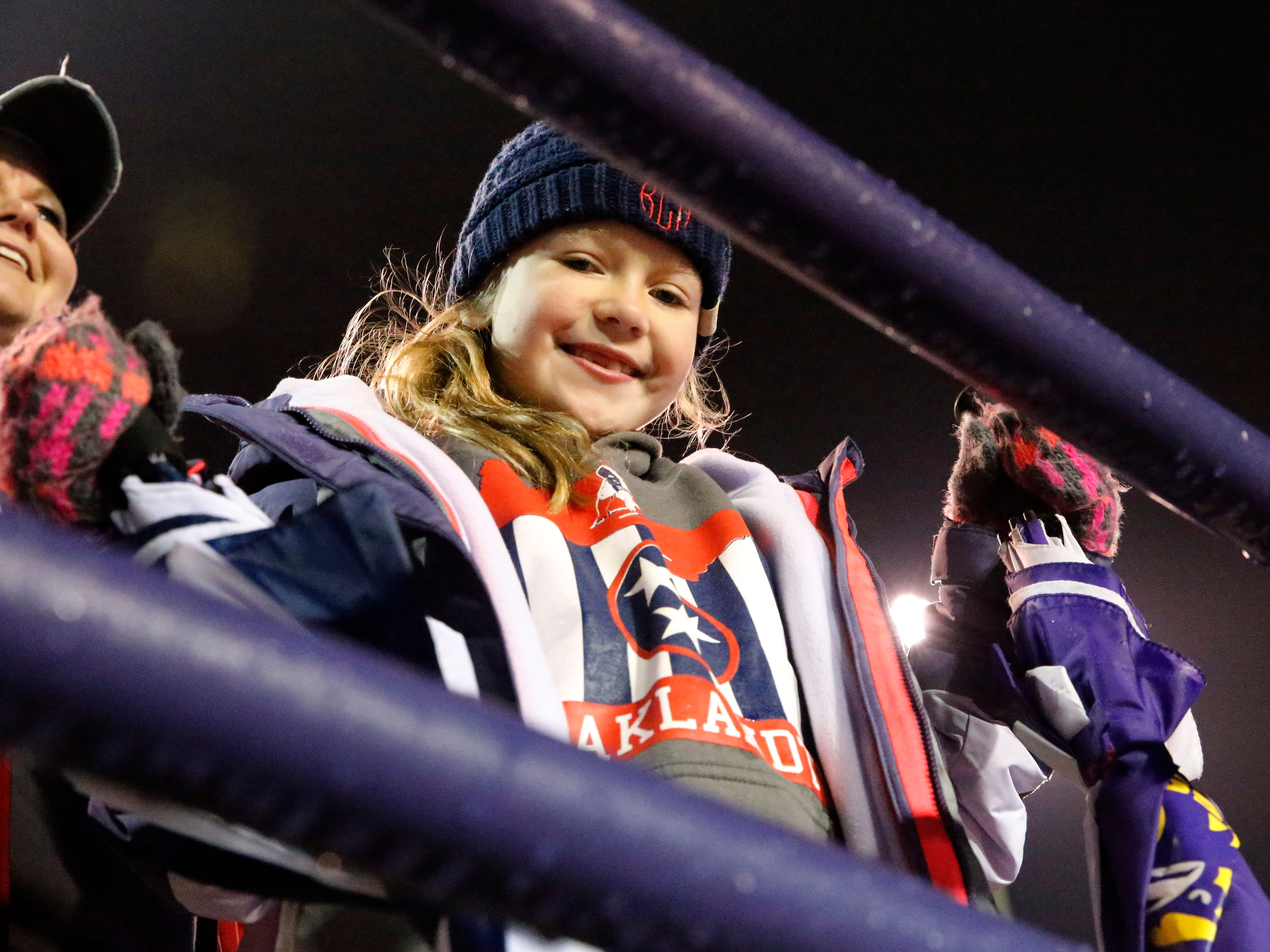 Oakland fan Kinley Creasy, the daughter of Oakland head coach Kevin Creasy is bundled up before the Class 6A BlueCross Bowl state championship at Tennessee Tech's Tucker Stadium in Cookeville, Tenn., on Thursday, Nov. 29, 2018.