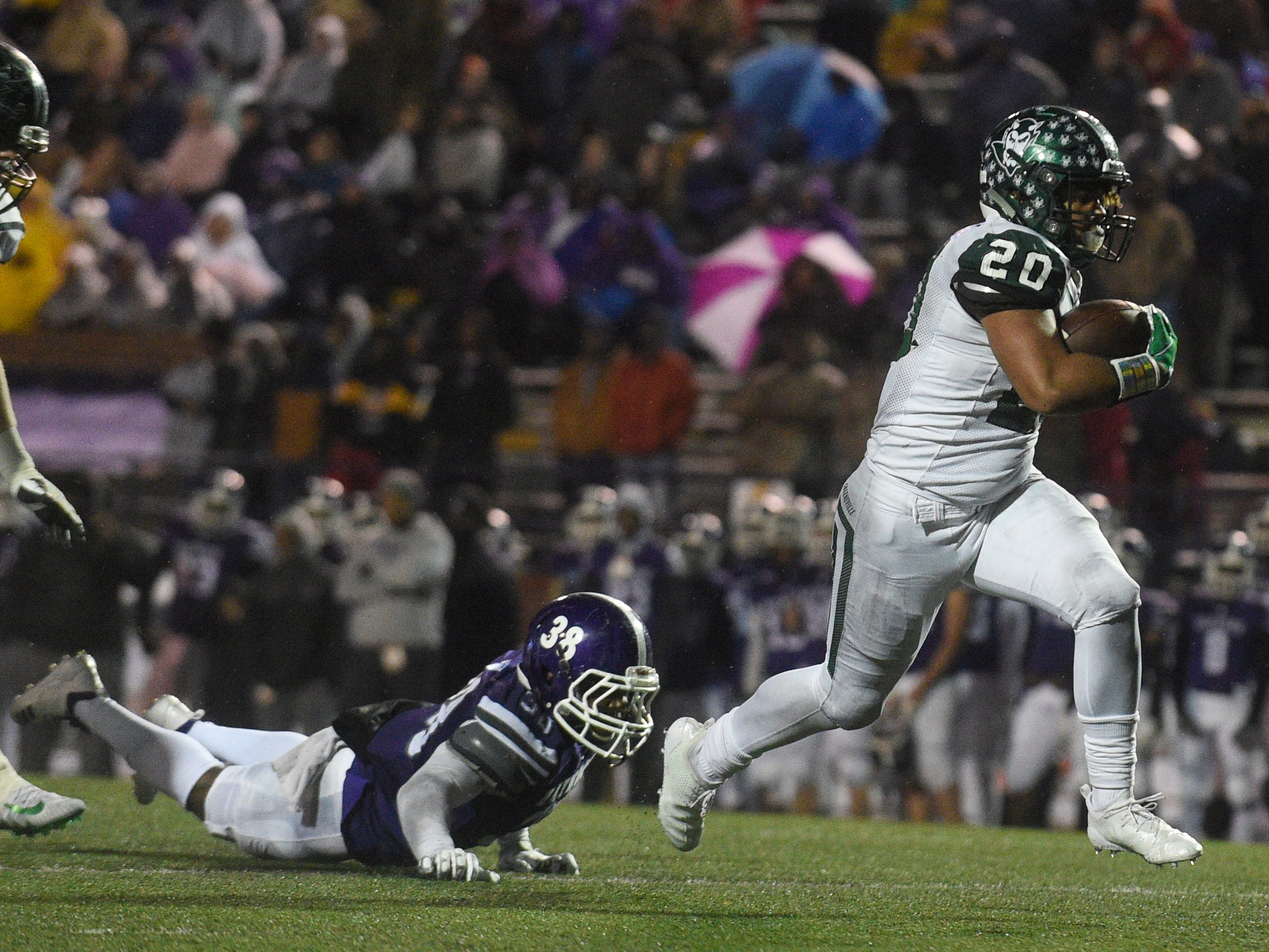 Greeneville's Jaevon Gillespie (20) heads for the endzone for a second-half touchdown during the Class 4A BlueCross Bowl state championship at Tennessee Tech's Tucker Stadium in Cookeville, Tenn., on Thursday, Nov. 29, 2018.
