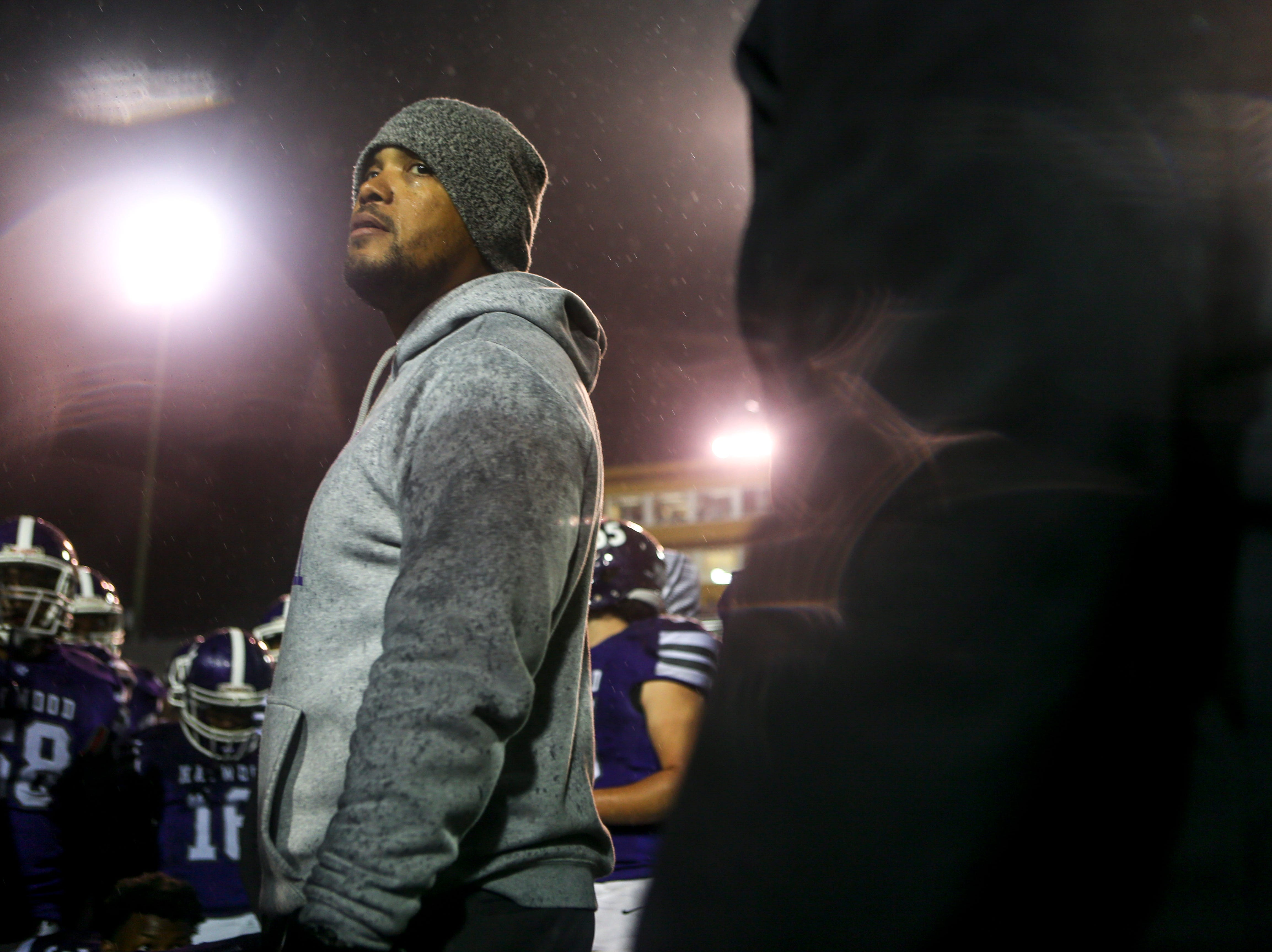 Steve Hookfin looks out over his players in a huddle after losing the Class 4A Blue Cross Bowl between Haywood and Greeneville at Tennessee Tech's Tucker Stadium in Cookeville, Tenn., on Thursday, Nov. 29, 2018.