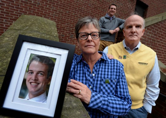Janice Langford stands next to a photo of her son, Justin Langford, along with her husband, Bryan Langford, and her other son, Kyle Langford, at Vanderbilt University on Thursday, Nov. 29, 2018, in Nashville. When Justin died, his organs were donated and saved five lives and improved 70 others. A likeness of his face will be created out of seeds and flowers and put on the Donate Life float in the Rose Parade on Jan. 1, 2019. Kyle Langford is in medical school at Vanderbilt.