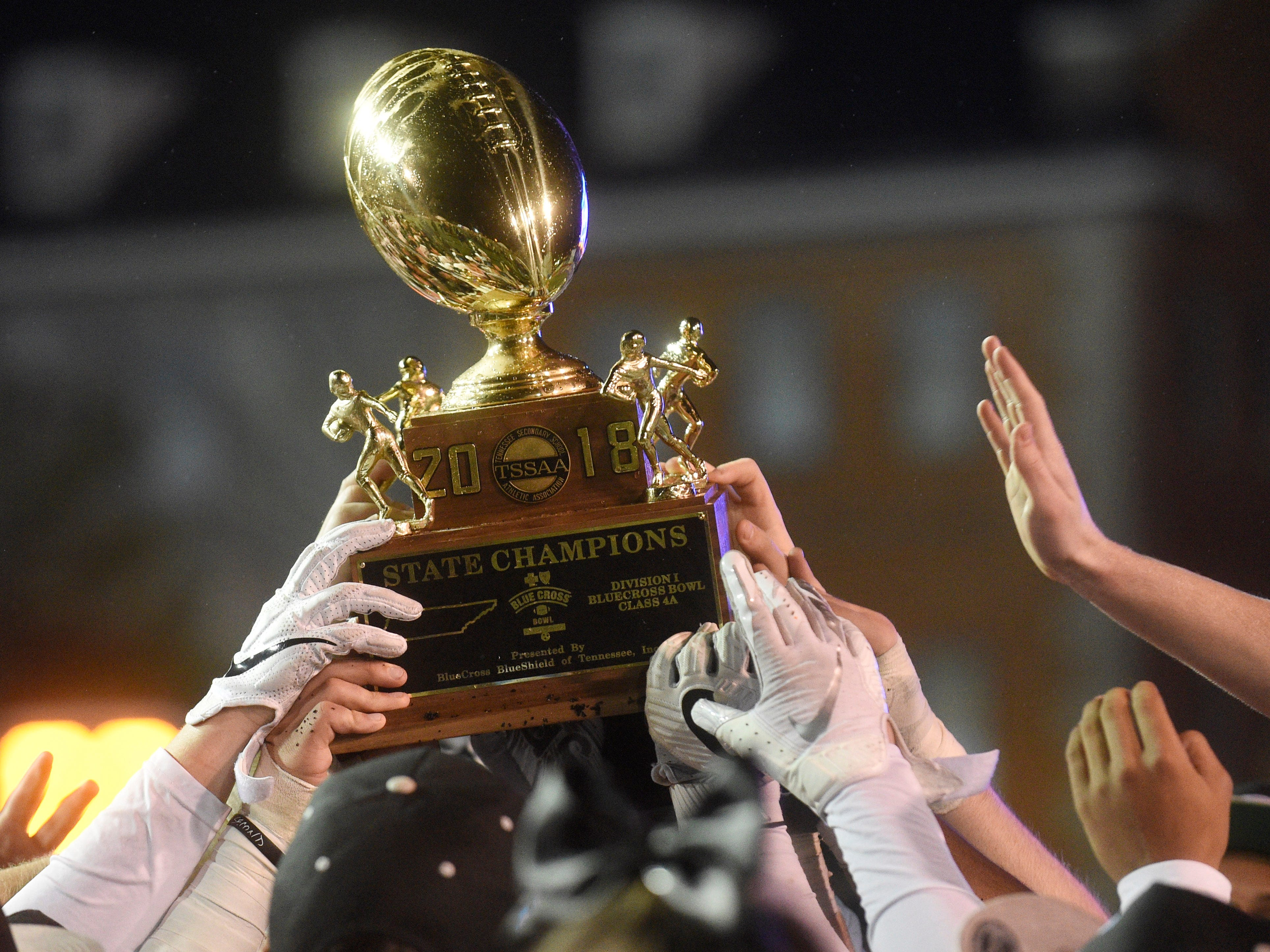 Greeneville players hold their trophy in the Class 4A BlueCross Bowl state championship at Tennessee Tech's Tucker Stadium in Cookeville, Tenn., on Thursday, Nov. 29, 2018.