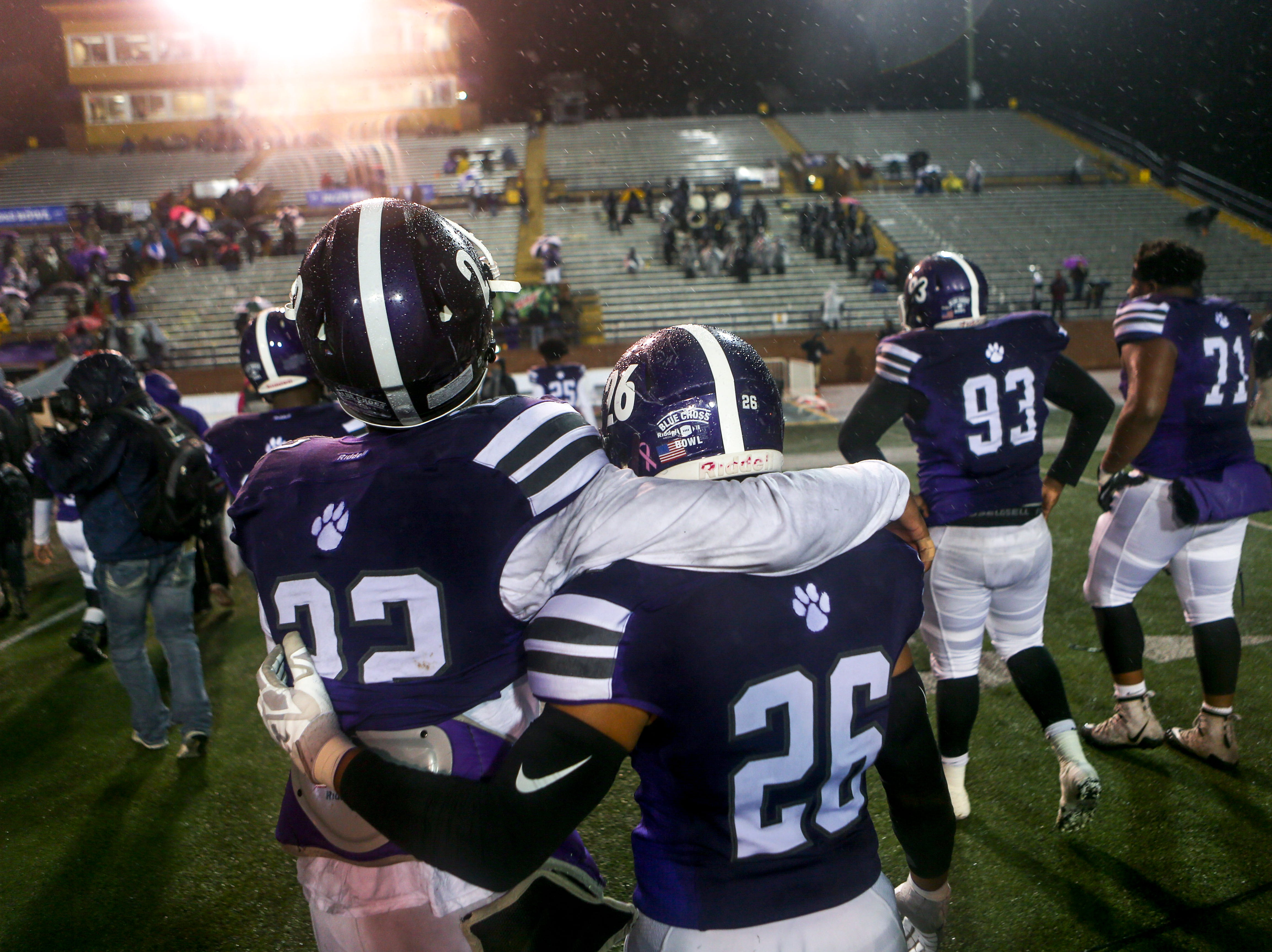 Haywood's Jadarius Tyus (22) and Haywood's Terrion Wilks (26) walk arm in arm off of the field after losing the Class 4A Blue Cross Bowl between Haywood and Greeneville at Tennessee Tech's Tucker Stadium in Cookeville, Tenn., on Thursday, Nov. 29, 2018.