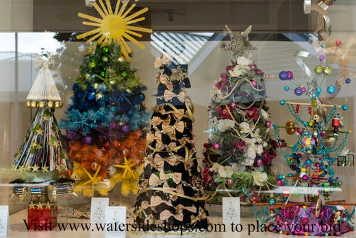 naples waterside shops is hosting a season of giving which allows an interested bidder buy photo