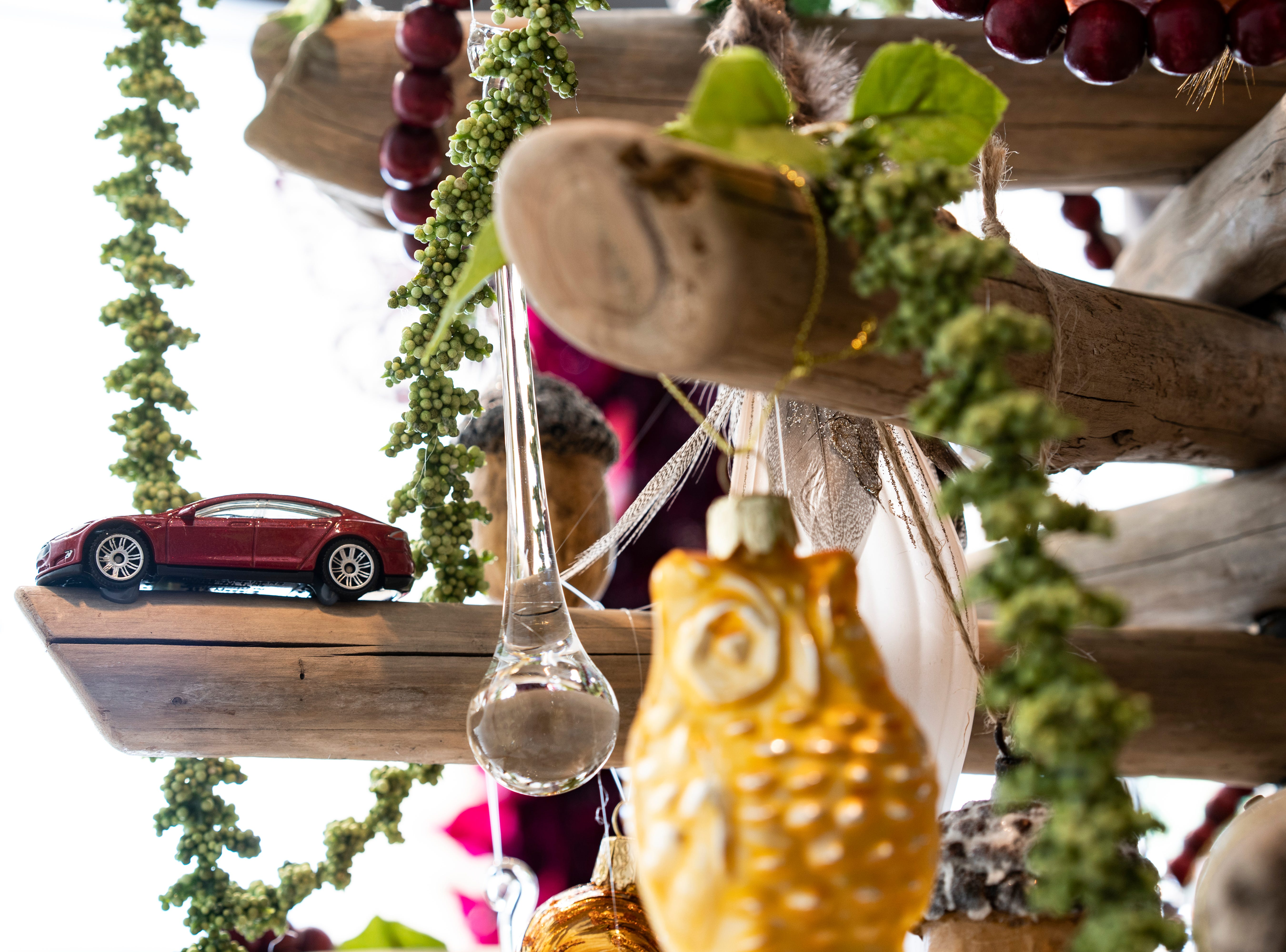 Tesla donated a driftwood Christmas tree decorated with miniature Tesla cars and a variety of ornaments depicting wilderness to raise funds for the Conservancy of Southwest Florida.  Waterside Shops is hosting A Season of Giving, in which bids are placed on 10 elegantly decorated Christmas trees displayed at stores in the center, each in support of a nonprofit in the Naples area. The bidding and display close on Thursday, Dec. 6, 2018.