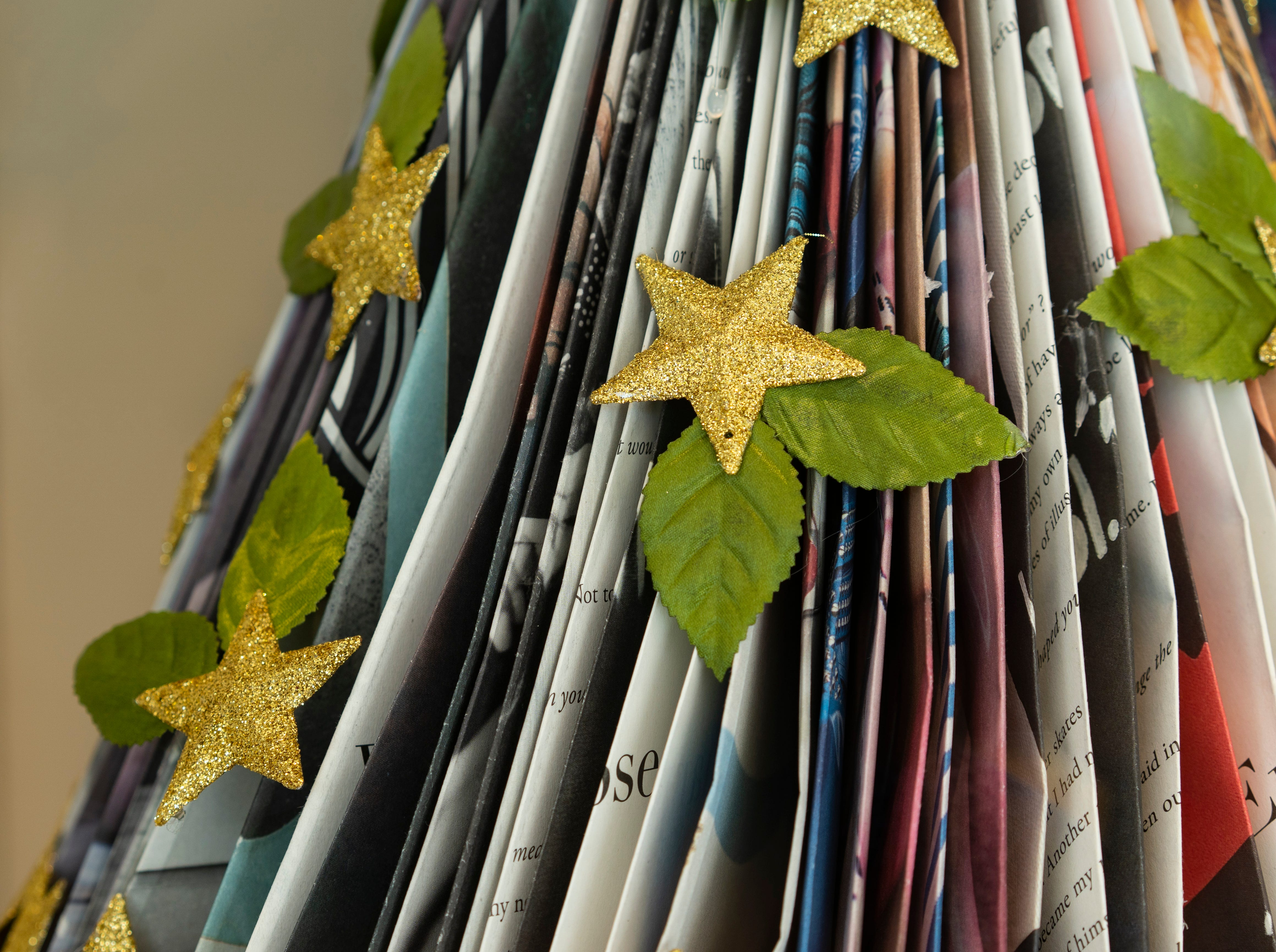 Talbots clothing store donated a paper folded Christmas tree with stars and stacks of book ornaments to raise funds for Champions For Learning.   Waterside Shops is hosting A Season of Giving, in which bids are placed on 10 elegantly decorated Christmas trees displayed at stores in the center, each in support of a nonprofit in the Naples area. The bidding and display close on Thursday, Dec. 6, 2018.