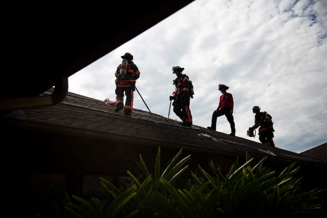 From left to right, Lt. Ken Duffy, Mark Smith, captain in training Brian Torres, and Engineer John McDaniel practice cutting holes in the roof of a building during a training scenario conducted by the North Collier Fire Control & Rescue District on Friday, Nov. 30, 2018, at Quail Creek Country Club in northern Collier County.
