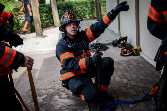 Lt. Nick Stolts instructs Jeff Green and Nick Currao on how to enter a building through a high ground floor window during a training scenario conducted by the North Collier Fire Control & Rescue District on Friday, Nov. 30, 2018, at Quail Creek Country Club in northern Collier County.