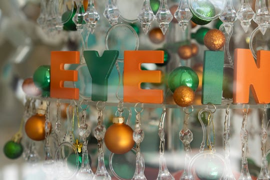 OMEGA Boutique donated an eye chart Christmas tree with eyeglasses and traditional ball ornaments in the signature University of Miami colors of orange and green to raise funds for the Bascom Palmer Eye Institute.   Waterside Shops is hosting A Season of Giving, in which bids are placed on 10 elegantly decorated Christmas trees displayed at stores in the center, each in support of a nonprofit in the Naples area. The bidding and display close on Thursday, Dec. 6, 2018.