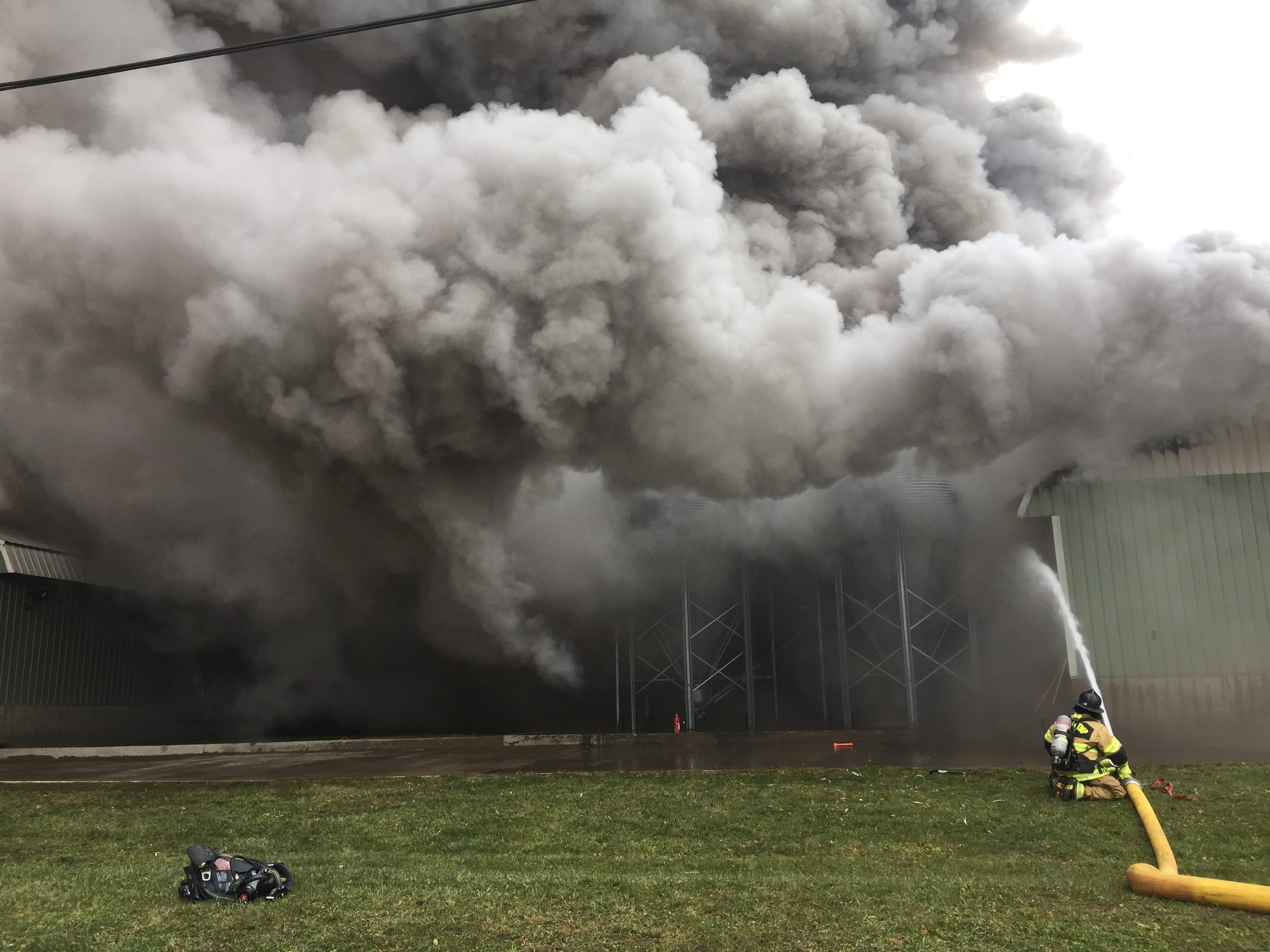 Firefighters battle a blaze at Trillium Farms in Croton.