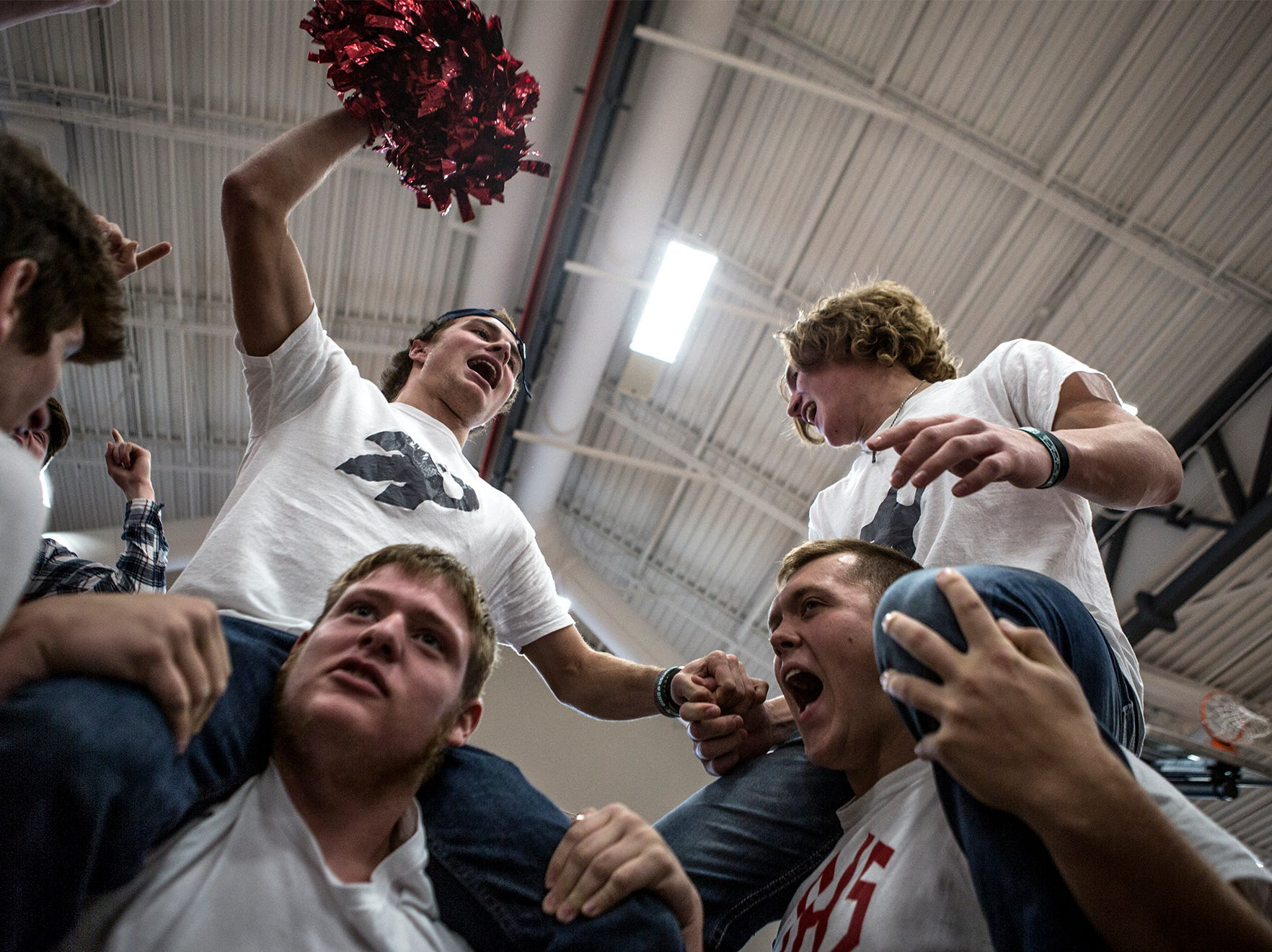 The senior Johnstown football players, along with fellow senior students cheer as loud as they can during a pep rally Friday morning ahead of the teams' game state championship game Saturday. Johnstown will take on Orville at 3 pm Canton.