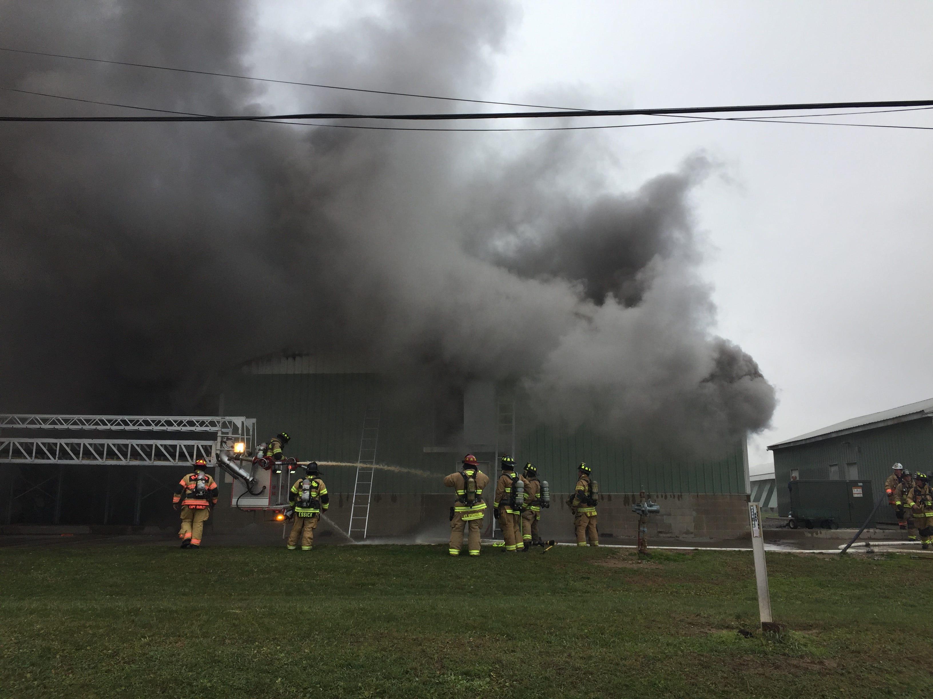 Firefighters battle a fire at Trillium Farm.s