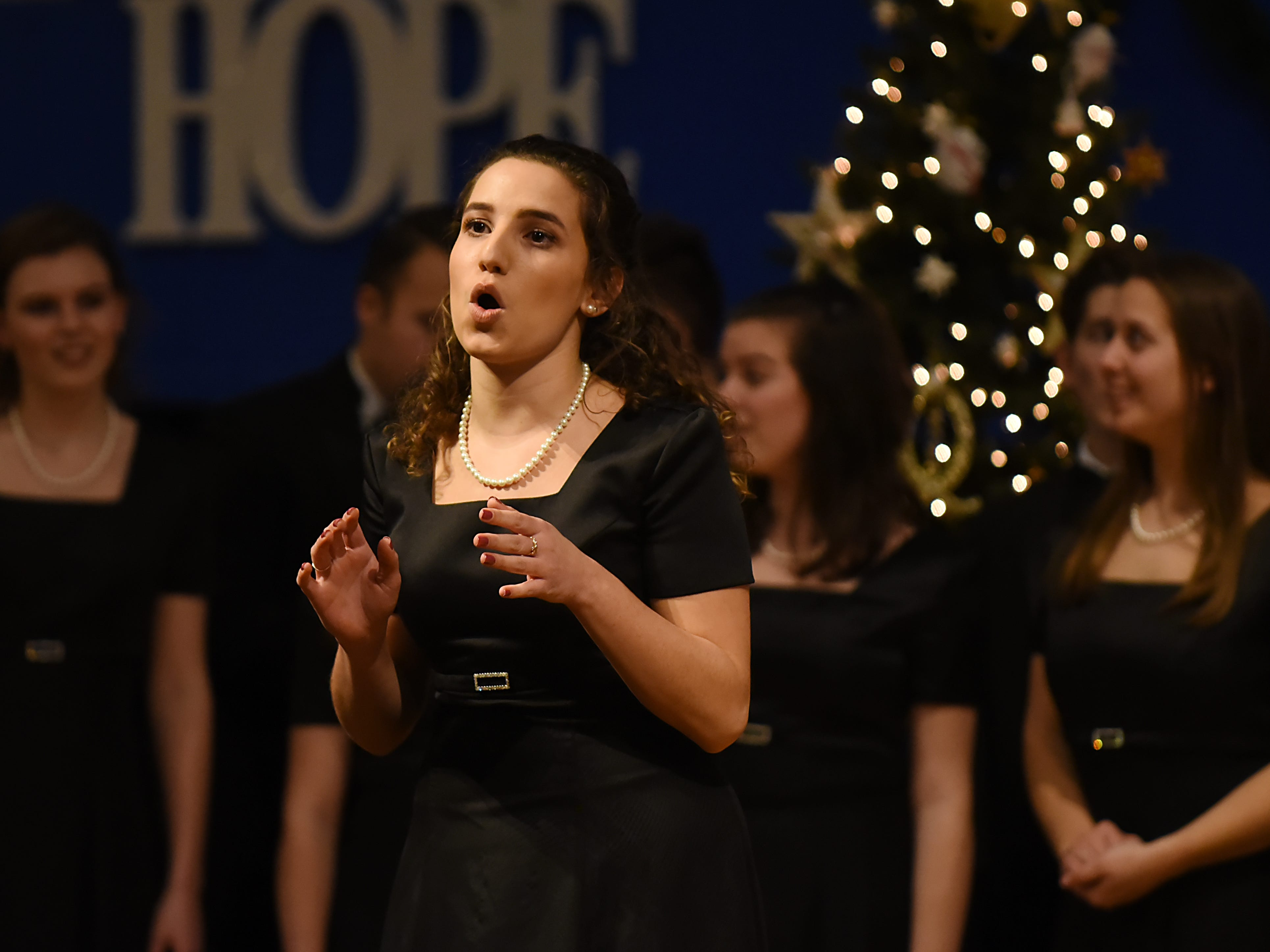 Marissa Forte sings a solo during the Morris Knolls Madrigal Choir dress rehearsal at Denville Community Church in Denville on Thursday November 29, 2018 prior to their performance at the White House.