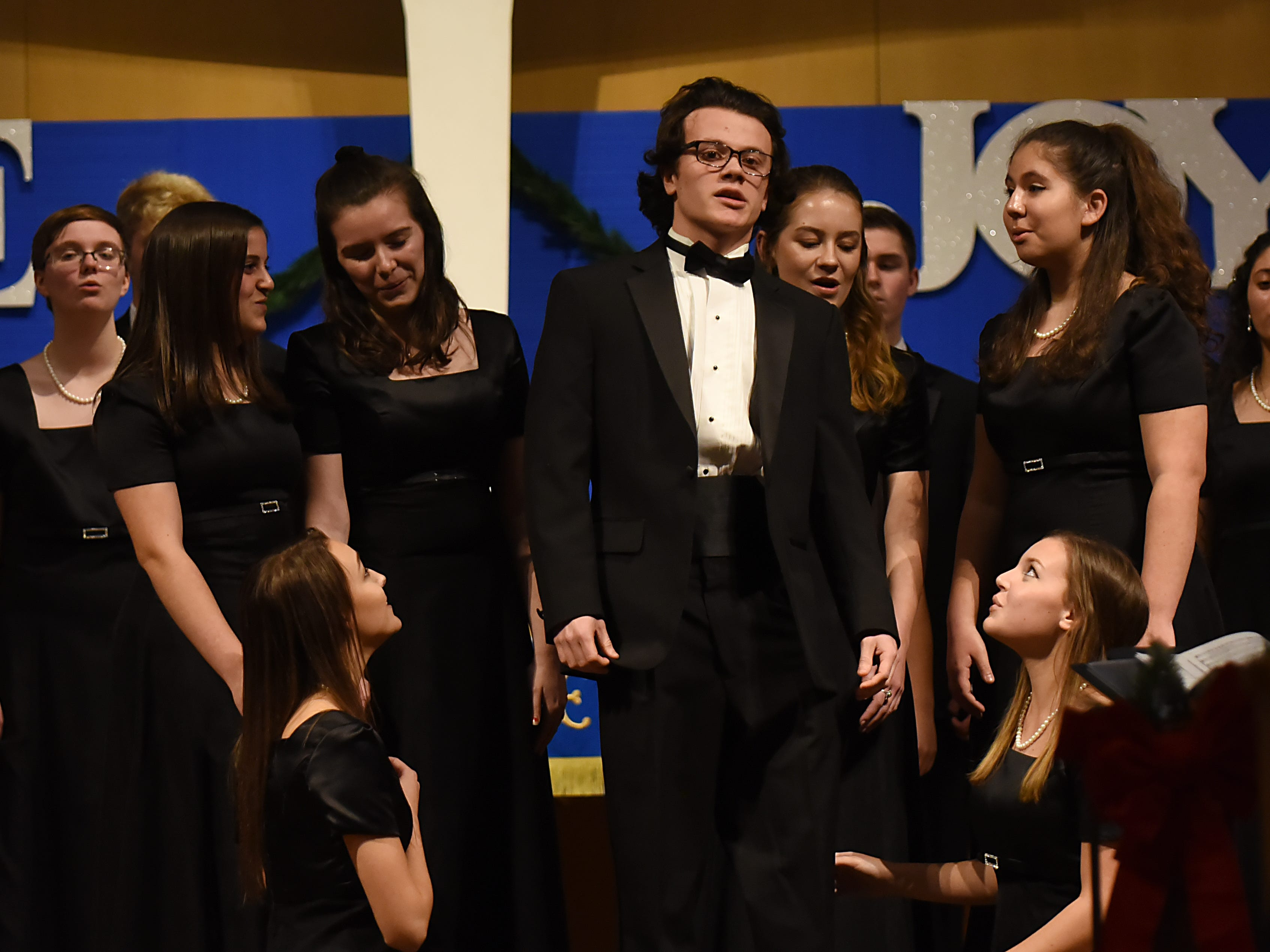 Daniel Perrault, center, sings during a Morris Knolls Madrigal Choir dress rehearsal at Denville Community Church in Denville on Thursday November 29, 2018 prior to their performance at the White House.