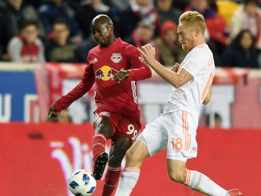 official photos d40b5 485ff NY Red Bulls' Derrick Etienne, from Paterson NJ, plays close ...