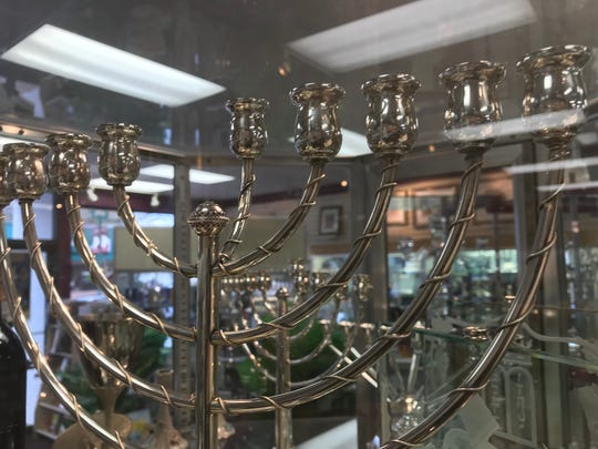 "A menorah has eight branches, plus a holder for a ninth ""servant"" candle."