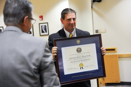 Police Chief Jeremy Abrams is pictured receiving a plaque from Harry Delgado of the New Jersey Chiefs of Police Association in 2014 for excellence in the Montvale Police Department.