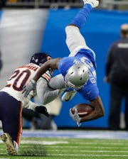 Chicago Bears cornerback Prince Amukamara (20) upends Detroit Lions wide receiver Bruce Ellington (12) during the first half of an NFL football game, Thursday, Nov. 22, 2018, in Detroit.