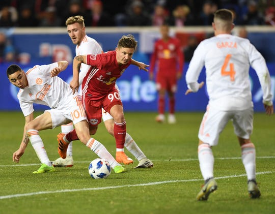 Atlanta at Red Bulls in Eastern Conference finals on Thursday, November 29, 2018. RB #90 Marc Rzatkowski gets past A #10 Miguel Almirón in the second half.