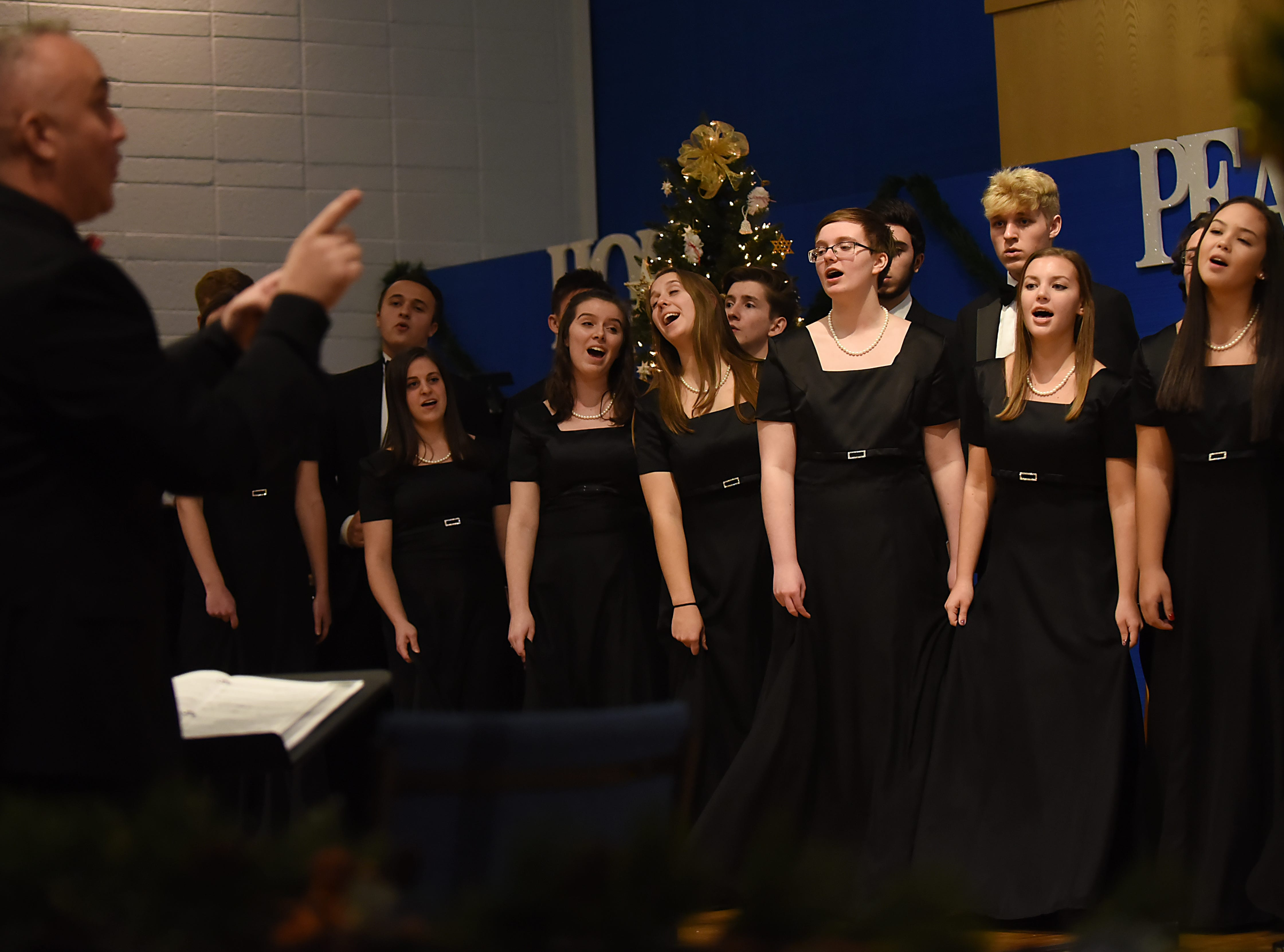 Michael Semancik leads the Morris Knolls Madrigal Choir during a dress rehearsal at Denville Community Church in Denville on Thursday November 29, 2018 prior to their performance at the White House.