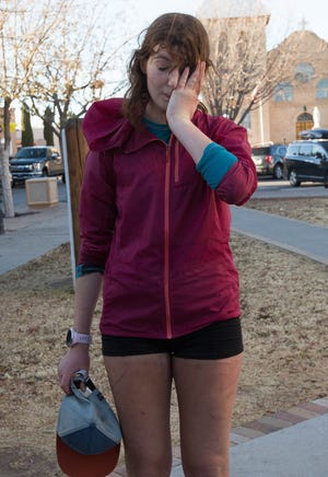 Ella Raff stands in Plaza de Mesilla exhausted after her 300-plus-mile run on the monumental loop trail Friday, Nov. 30, 2018. Raff became the first person to run the traditional mountain-biking route.