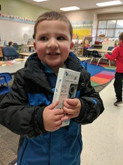 A student at Desert Hills Elementary receives a free Kinsa thermometer.