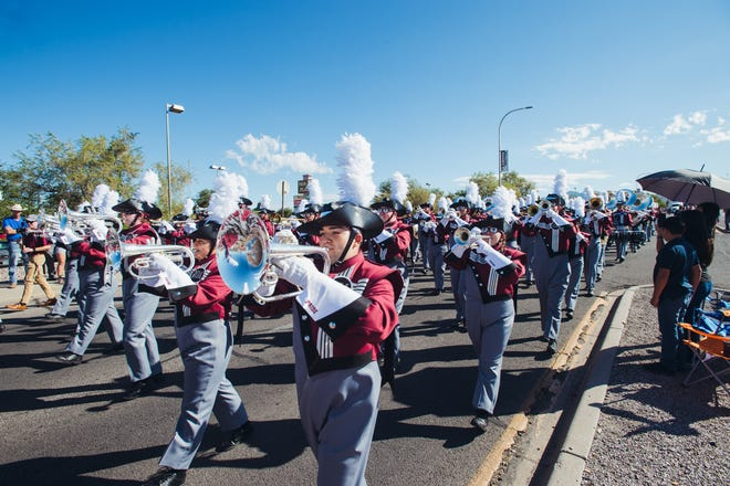 The New Mexico State University  Aggie Pride Band marches through the 2018 homecoming parade.
