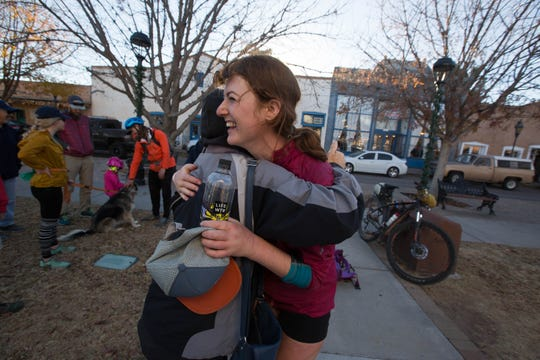 Marjie Snell hugs Ella Raff in the Plaza de Mesilla, welcoming Raff after her 300-plus-mile run on the Monumental Loop trail, Friday November 30, 2018.