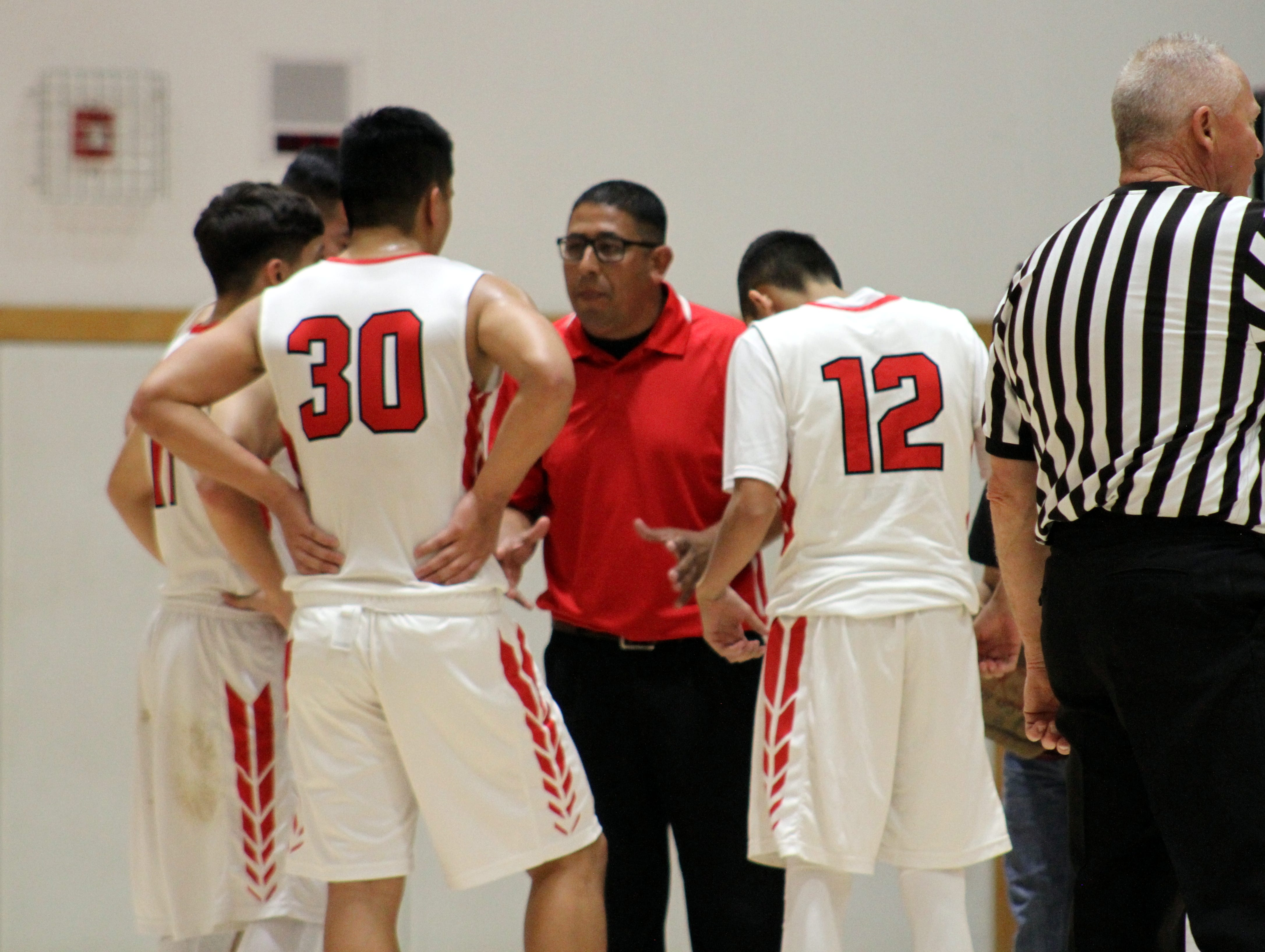 Loving coach Bobby Parraz talks to his team in a timeout during Thursday's game.