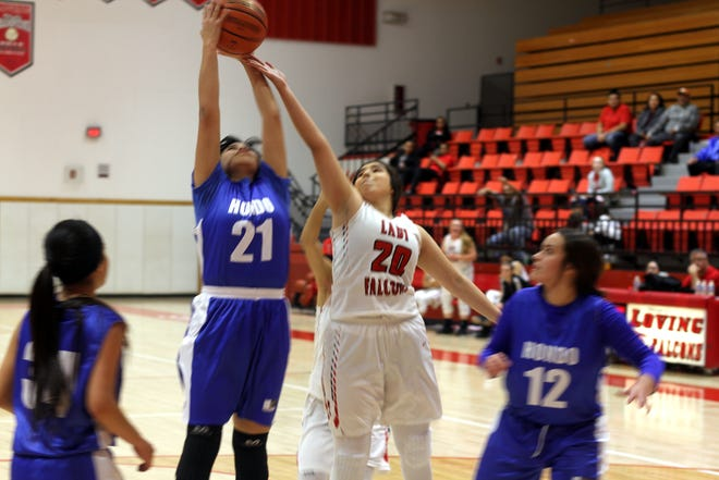 Loving's Diana Cueto (20) battles a Hondo player for a rebound during Thursday's game.