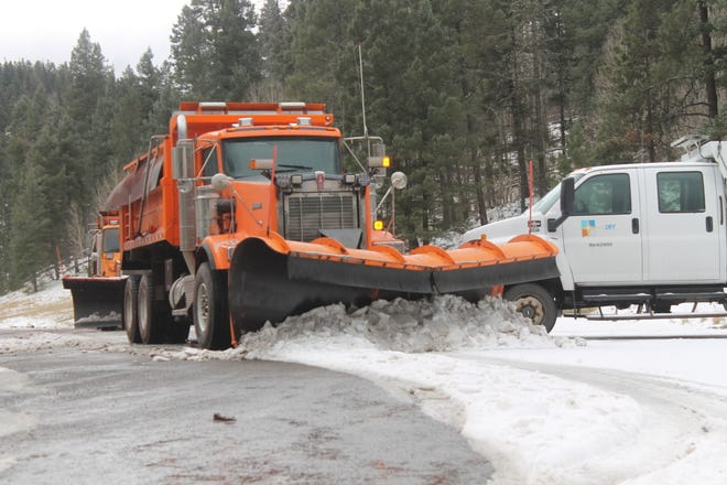 Snow plows cleared snow on U.S. Highway 82 near Cloudcroft. Snow accumulated in the area Thursday night and Friday morning.