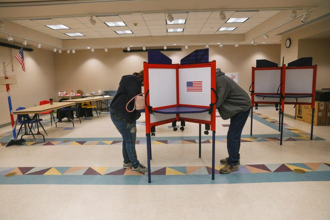 Voters fill out their ballots on March 6 at the Farmington Museum at Gateway Park.