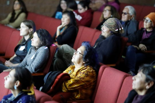 "An audience watches the documentary ""Dii'go Tó Baahaane': Four Stories About Water"" at the International Uranium Film Festival on Thursday at the Navajo Nation Museum in Window Rock, Ariz."