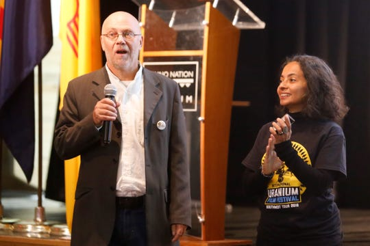 International Uranium Film Festival founders and directors Norbert Suchanek and Márcia Gomes de Oliveira address the audience at the start of the event on Thursday at the Navajo Nation Museum in Window Rock, Ariz.
