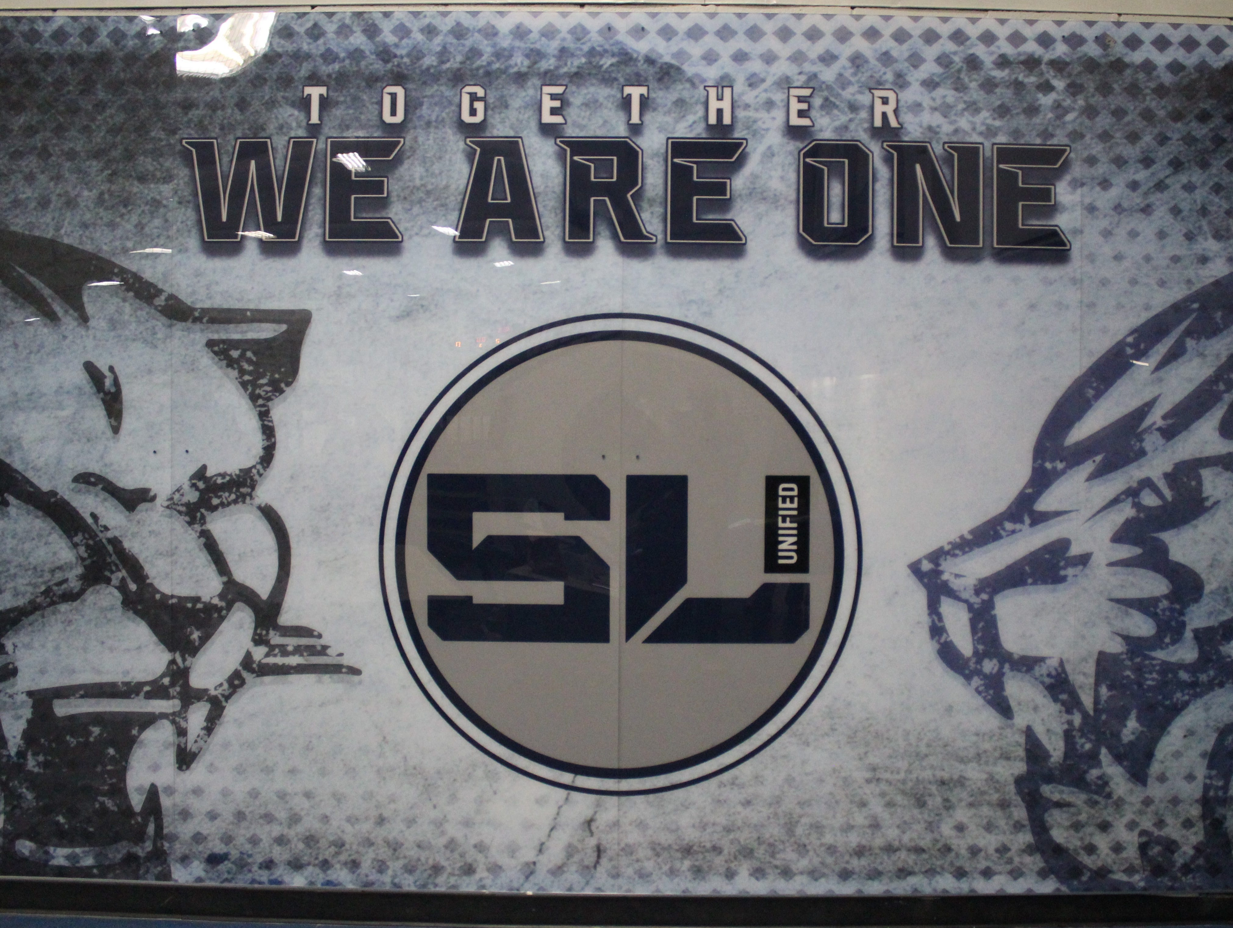 A full-sized wall mural outside the South Lyon Unified hockey team's locker room represents the unification of South Lyon and South Lyon East high schools.