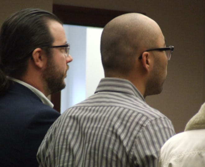 Zong Zhang, right, and defense attorney Brian Craigo in court on Thursday. Zong pleaded guilty to two charges related to a Livonia house that had been turned into a marijuana-growing operation; he and his mother owned the house but were not growers.